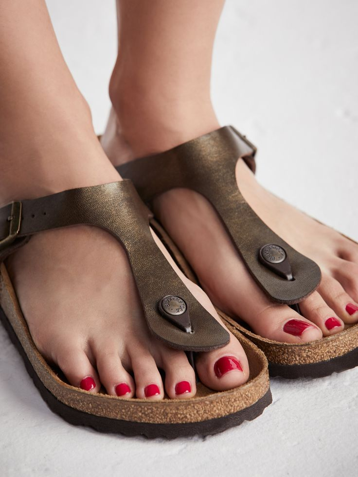 Gizeh Birkenstock   Classic Birkenstock silhouette with a toe thong and adjustable fit.    * Birko-flor™ for a leather-like finish   * Birksentock cork footbed   * EVA sole   * Regular: C-D Width   * Sizing Tip: This style runs large, we recommend sizing down.