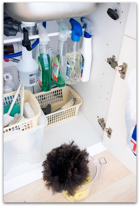 shower curtain rod under sink to organize bottles (and tons of other great tips!)