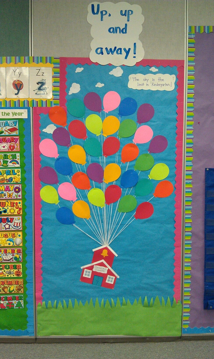 """Up, up and away!"" balloon bulletin board. The small cloud reads ""The sky is the limit in Kindergarten!"". When I meet my new students, I'll snap their picture and put it on a balloon with their name. The board will stay up for the rest of the year."