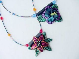 Use polymer clay, floral stamps and multi-colored glitter to create the most beautiful necklace pendants.  #tutorial