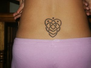 Celtic motherhood tattoo... my next one. except not as a tramp stamp....