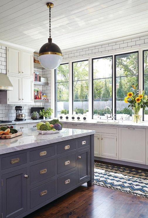 White walls, black windows, Moroccan runner with gray cabinets #kitchen: