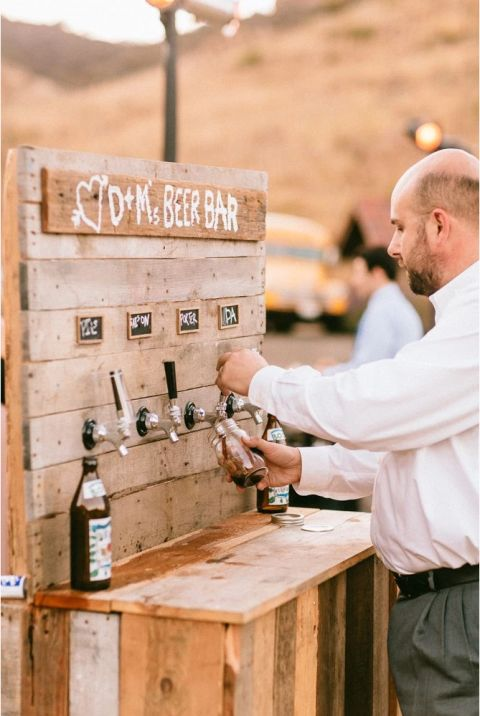 Fun's on tap when you have an outdoor beer bar for guests to serve themselves, like at this ranch wedding where the groom's home-brewed beer was available for all to enjoy. Photo credit: The Melideos
