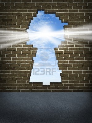 Break through and the solution or answer to success as a breaking down walls concept for business or a free your mind icon for personal concepts with an old urban brick wall with a damaged hole in the shape of a key hole