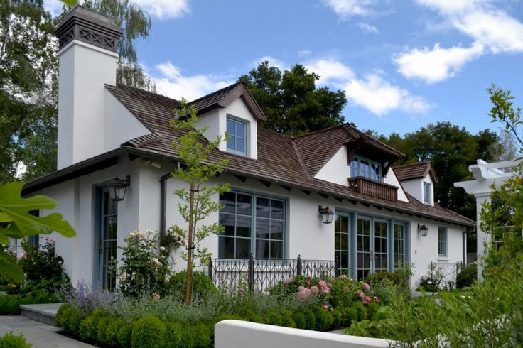 White house brown roof exterior traditional with mass plantings french doors