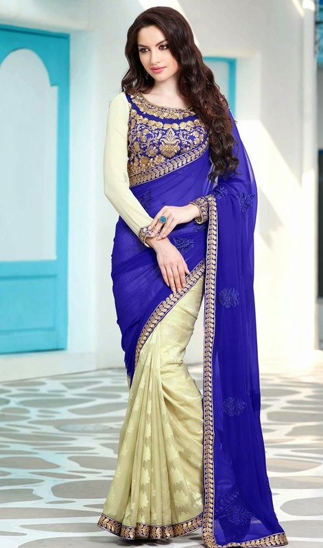 Give gorgeous look draped in this blue and cream georgette, jacquard half n half sari. The stunning lace, patch and resham work in the course of the attire is awe-inspiring. #LovelyKundanPattiLaceWorkSaree