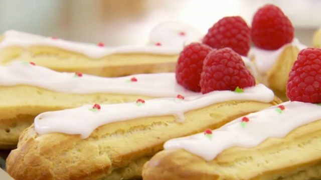 This raspberry ripple eclairs recipe is featured in The Great British Baking Show airing on PBS. Get the recipe at PBS Food.