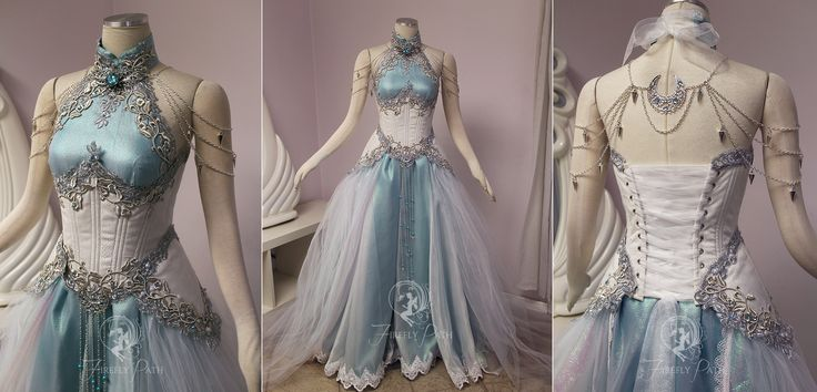 Our customer has an affinity for dragons and commissioned us to design and create a gown that suited her fantasy persona. We used crimson red dupioni silk in her corset, the center panel has dragon...