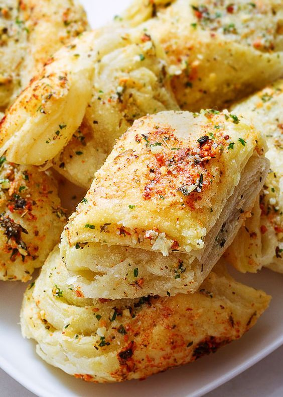 Try these incredibly easy, fool-proof parmesan garlic bites. They come together in less than 20 min and use just basic pantry ingredients. eatwell101.com