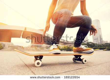 skateboarding woman in the city - stock photo