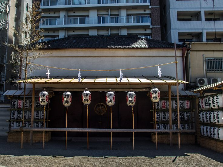 Asakusa Jinja's storehouse where the three honsha (main and holy omikoshi) all decorated for the upcoming Sanja Matsuri. The gate is still closed because the kami (divine spirits) haven't been transferred to the omikoshi yet. #Asakusa, #Jinja, #honsha, #omikoshi, #Sanja, #Matsuri May 12, 2016 © Grigoris A. Miliaresis