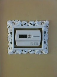 Placing an ornate frame around our thermostat to make it a little less ordinary.