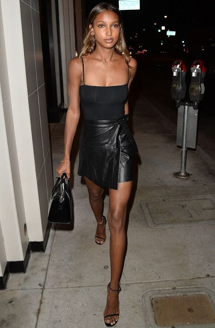 Celebrities In Leather: Jasmine Tookes wears a leather skirt