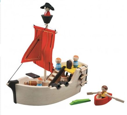 Wooden Pirate Ship Play Set ~ Ship Ahoy...!  This gorgeous wooden Pirate Ship play set features a gang plank, a pair of cannon, a rigged mast with crows nest, a helm, dangling anchor, a rowing boat, cargo, captain and crew...and don't forget to beware of the crocodile!!!  This fun Pirate Ship has a gangway at the back that can be opened to access the cargo hold.  Suitable for ages 3+ £64.99