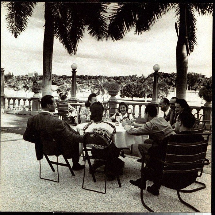 Friends chat at a country club table in Havana in 1941.