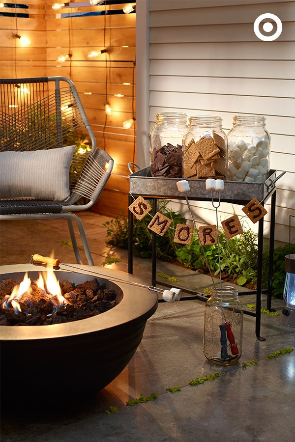For almost-effortless hosting and some seriously satisfied sweet tooths, throw together a build-your-own s'mores bar. A galvanized steel outdoor plant stand and a few large mason jars filled with graham crackers, chocolate bars, and marshmallows make for a pretty perfect s'more setup.