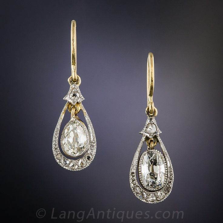 Antique Pear Shaped Diamond Drop Earrings. Sweet and lovely, and eminently wearable diamond ear drops dating from the first decade of twentieth century. A pair of old mine-cut diamonds sparkle from within finely milgrained platinum bezel settings and swing back & forth inside delicate frames glittering with tiny rose-cut diamonds. Lightly and lovingly hand fabricated in platinum over 18K yellow gold