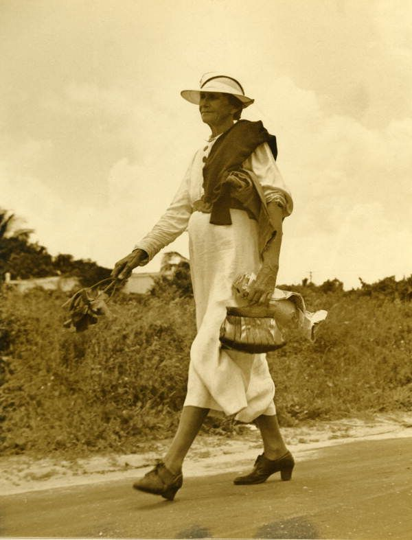 Florida Memory - View of Izzelly Hardin, mid-wife, walking on the road - Riviera Beach, Florida