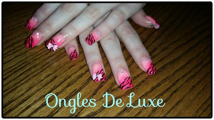 Pink ombre nails with zebra and bows