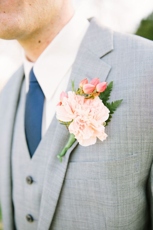 Blush coloured peonie boutonnierre for the groomsmen