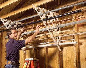 Plastic lattice works well for storing long lengths of miscellaneous pipe, trim, flashing and conduit. Just cut matching pieces, then screw 2x4 cleats to the ceiling and screw the lattice to the wall studs and cleats. Now you can quickly find those oddball leftovers instead of going to the hardware store and buying yet another piece.