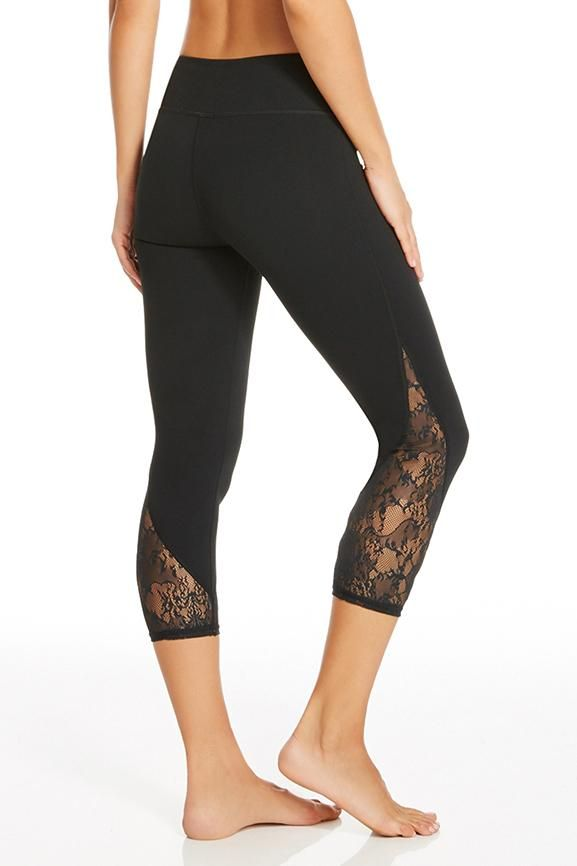 These lace detailed yoga leggings may look sweet, but the performance factors are hardcore. Stretch, sweat and move in fall's must-have bottoms. | Tuberose Capri - Fabletics