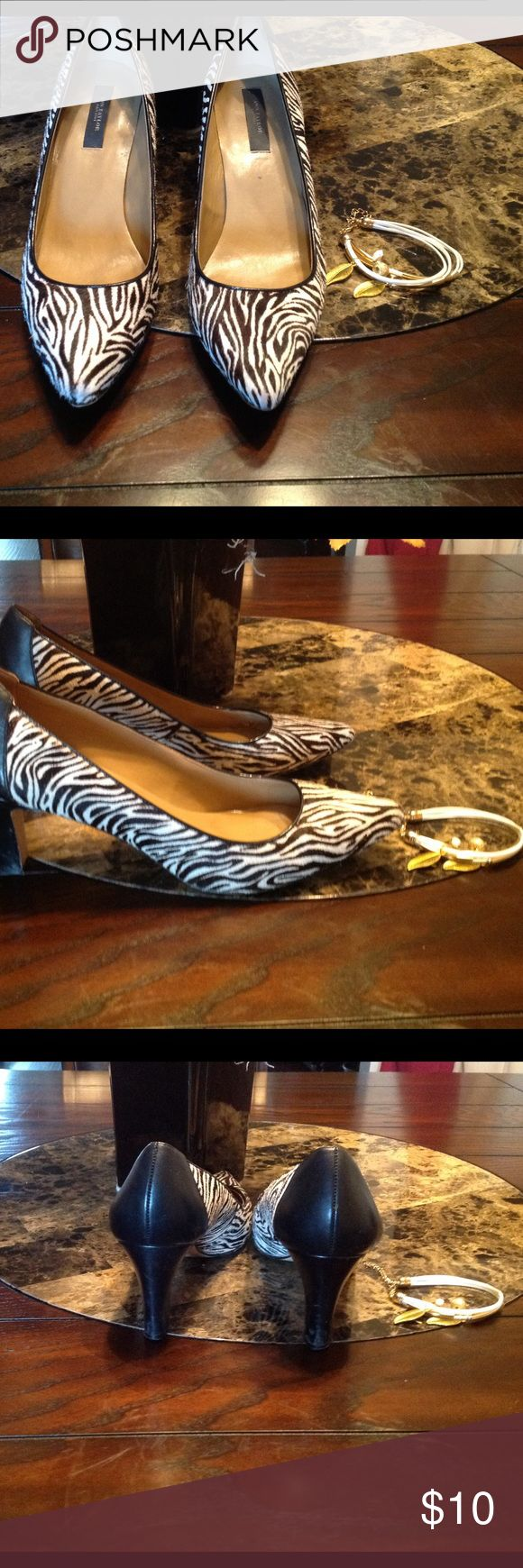 Ann Taylor zebra shoes.   Size 8.5. Good condition.    Wear on bottom, reflected in price. Ann Taylor Shoes