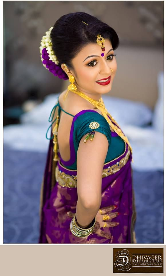 South Indian bride. Gold Indian bridal jewelry.Temple jewelry. Jhumkis.Purple silk kanchipuram sari.Bun with fresh flowers. Tamil bride. Telugu bride. Kannada bride. Hindu bride. Malayalee bride.Kerala bride.South Indian wedding.