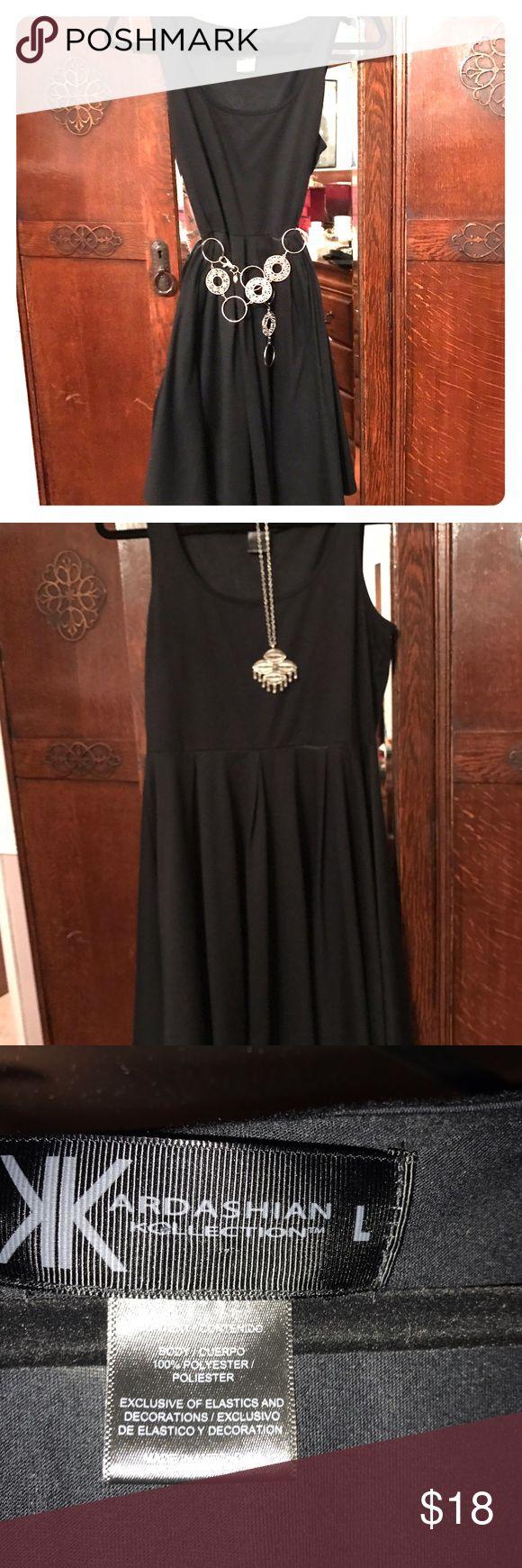 Kim Kardashian black shift dress. Flirty, cute shift dress. Dress up with heels and jewelry or down with flip flops, perfect. kim kardashian Dresses Mini
