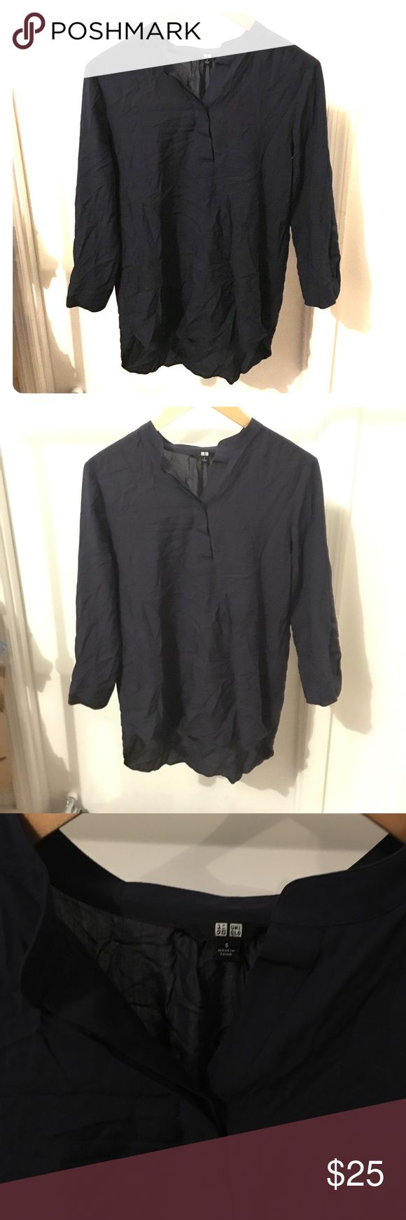 Uniqlo Navy Blue Tunic Top Size Small Four and airy Tunic Top. High low hem. Great condition - just wrinkled from storage. Rayon / poly blend. Size: small Uniqlo Tops Blouses