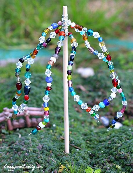 DIY beaded garden ornaments -- such a great family craft activity! They put theirs in the fairy garden.
