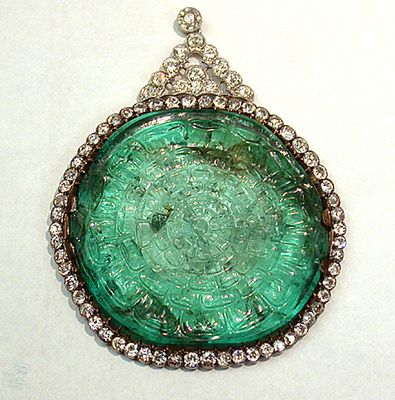 Mogul Emerald Necklace. Columbian emerald carved in India in the Mogul style. Surrounded by round diamonds and suspended from a double row of diamonds, total weight of 50 carats. Set circa 1900