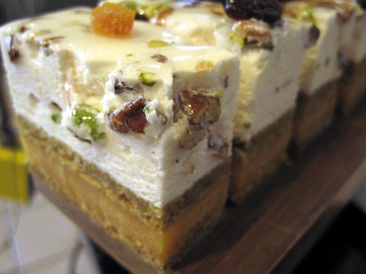 Nougat mousse cake: pistachio dacquoise, apricot-passion fruit gelee, and nougat mousse