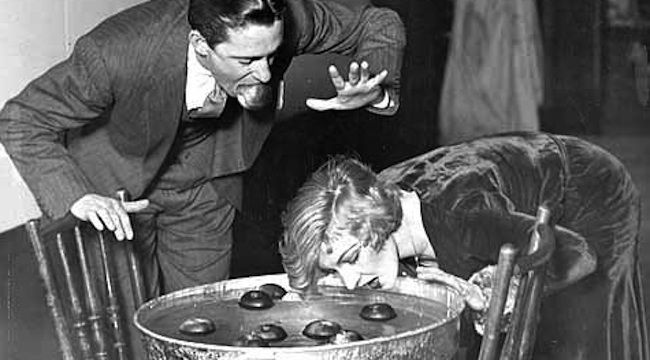 Bobbing for apples with a little help. 1930
