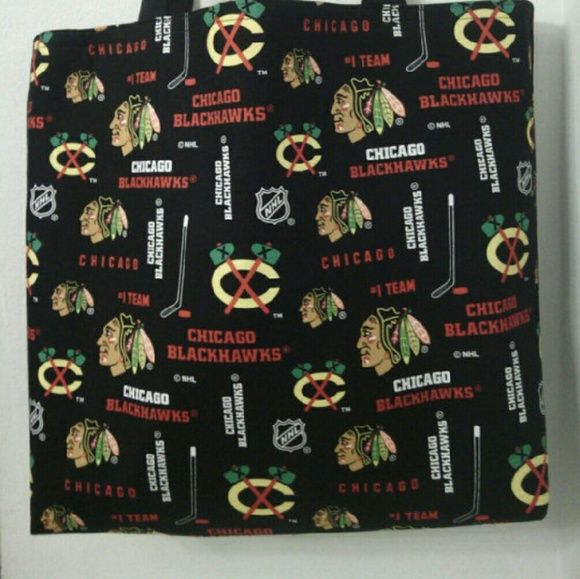 "Large Inspired Chicago Blackhawks Handmade Tote * Handmade? * 13"" H x 13"" W x 3"" D * Chicago Blackhawks cotton print outside * Solid Black cotton inside lining * Blackhawks print inside pocket.? * 2 - 24"" handles? * Medium interfacing was added for extra body durability. * I use criss-crossed stitches on each handles for added security.?   ** THIS IS NOT A LICENSED PRODUCT.? ** THE HANDLES AND INSIDE LINING MAY VARY FROM BAG TO BAG.  #chicagoblackhawks #blackhawks #chicago #hockey?? Handmade…"