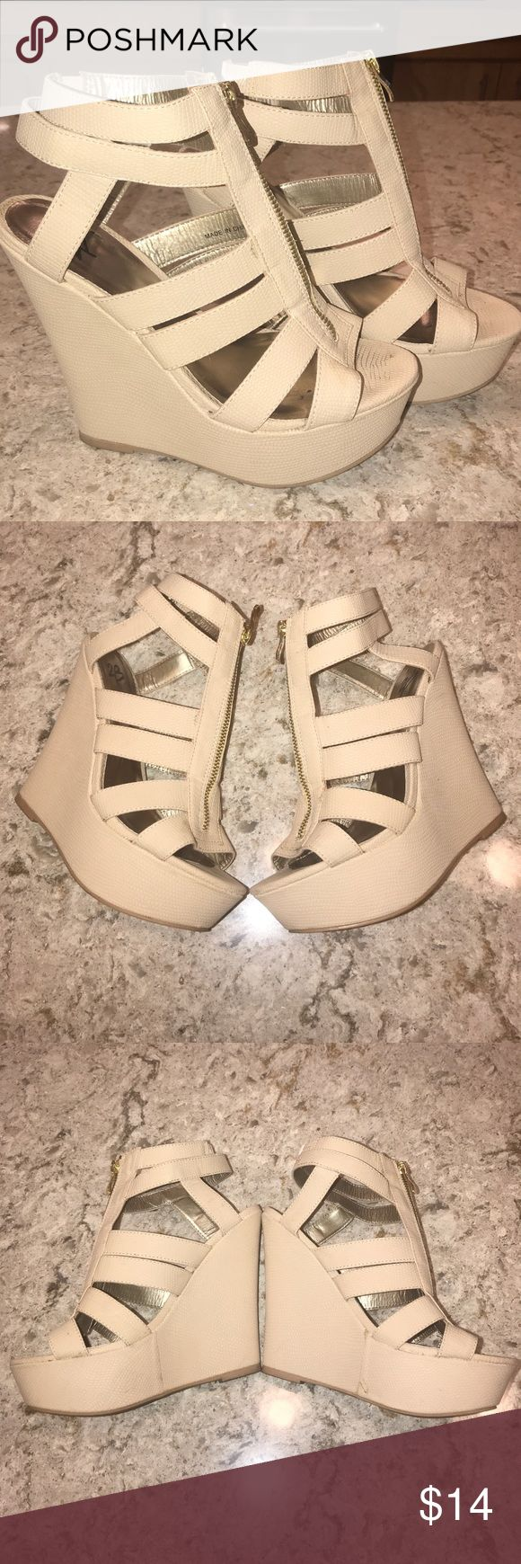 Strap Cream Wedge Heel Sandals Strappy Cream Wedge Heel Sandals. Size 8. True to size. Good condition. Some wear shown on the inside of the shoes and on the soles. Shoes Wedges