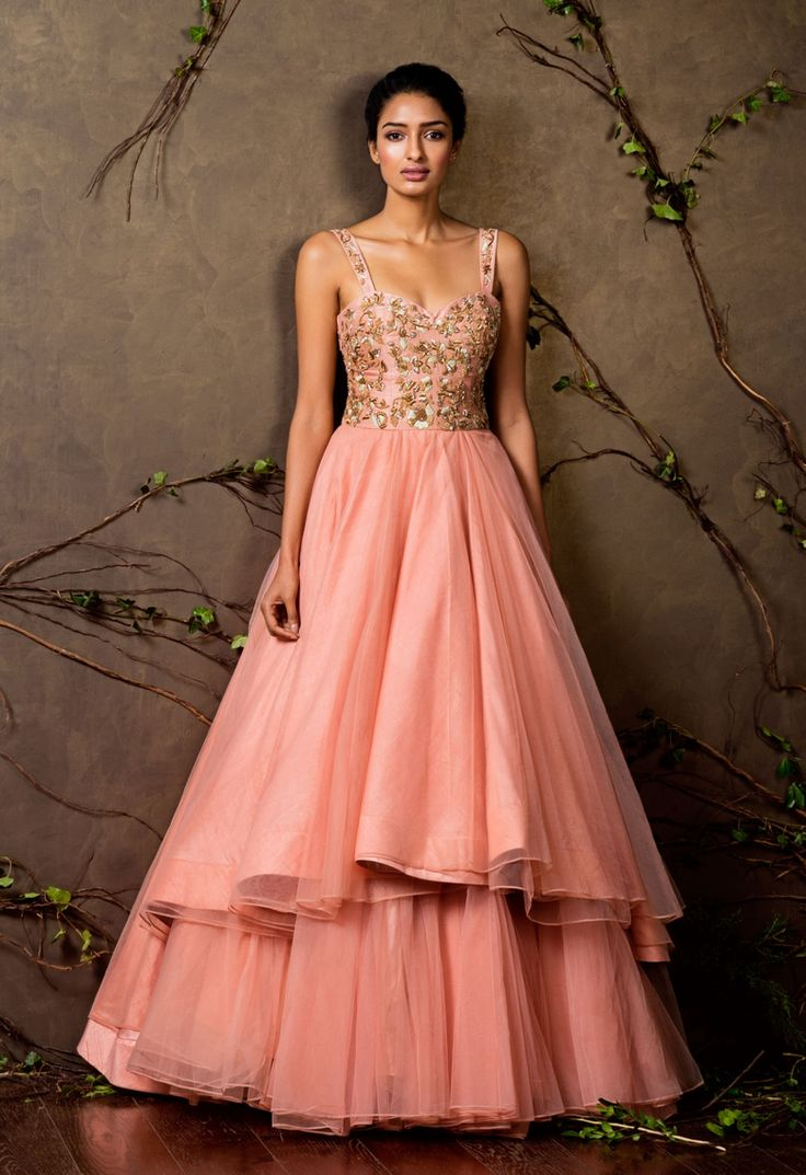 A stunning peach pearl raw silk and tulle asymmetric gown with hints of gold and zardozi embroidery on the bodice. Sales@shyamalbhumika.com www.shyamalbhumika.com