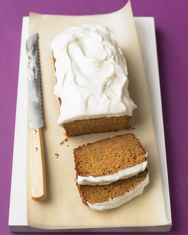 Grated carrot is the secret to the moist crumb and mellow sweetness of this loaf cake topped with thick swirls of tangy frosting.