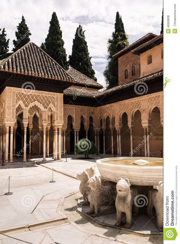 Courtyard decorated with a fountain at the historic site of the Alhambra in spain