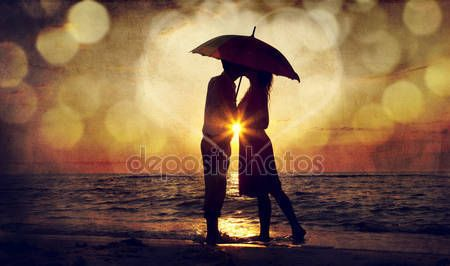 People Stock Images , People Pictures , person photo , - Couple kissing under umbrella at the beach in sunset. Photo in o