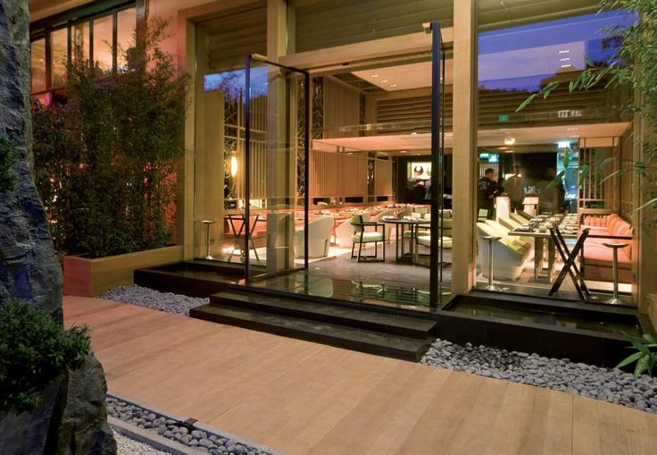 Vitrocsa pivoting doors. YOSHI, the first Joël Robuchon Japanese restaurant in the world  Architect: Didier Gomez.