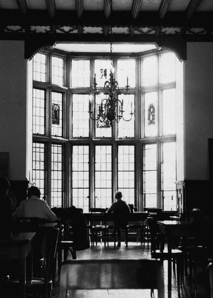 In the library, leather bound volumes filled the bookcases, while newly electrified desk lamps and chandeliers provided ample lighting. (Planting Fields, Oyster Bay, NY/Stony Brook University)
