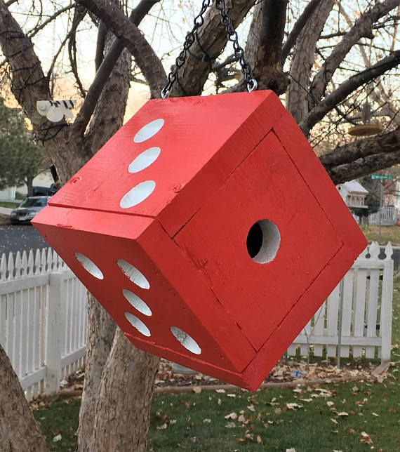 Cedar birdhouse, painted red with white dots. Each dot is drilled into the wood using a plunge router and individually hand painted giving this house such clean lines it really stands out and catches your attention. This is a 6 and one half inch cube, one side opens for cleaning ,