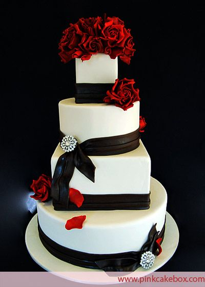 This elegant 4 tier round and square wedding cake includes red roses, black fondant ribbons and crystal brooches. The cake is filled with oreos and cream.