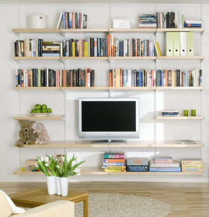 i like the smallish tv and the pretty books. it feels more like a reading room than a tv room but still there's the option?