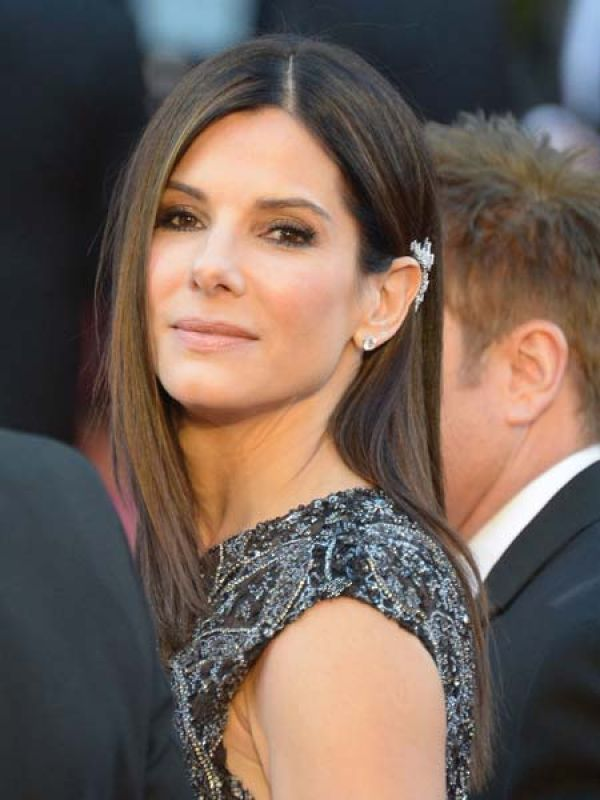 Sandra BullockThe ear cuffs got a chic makeover as Sandra Bullock opted for a diamond-studded Harry Winston piece with her sheer gown.