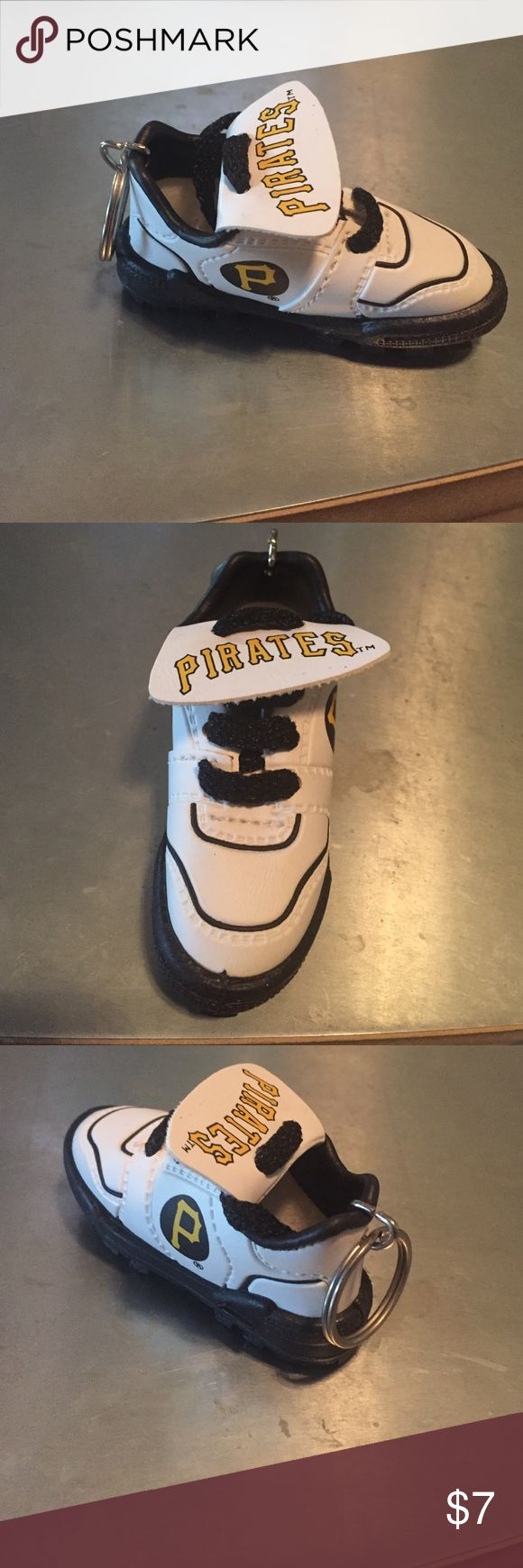 MLB Pirates Sneaker Key Chain Vintage MLB Pirates sneaker key chain. Pristine condition. Pirates logo on each side of sneaker & Pirates name on sneaker tongue. Also has actual laces that can be adjusted. Perfect for MLB and Pirates fans/collectors. MLB Accessories Key & Card Holders