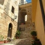 Part of the ancient wall of the old town and another typical stairway of Castellammare del Golfo
