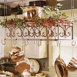 Hanging Pot Rack over Island.  Stiff hanging pot rack (instead of the possibly swingy link ones) over the stove island to display some of the nice cookware.  Nice tiered one so can decorate for seasons/ holidays/ occasions with trimmings.