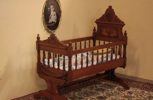 Wanna try Antique victorian swinging bassinet